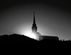 The Oquirrh Mountain Utah Temple spire in the evening, black and white.