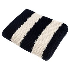"50""X60"" Knit cotton throw with true navy striping.  Product: ThrowConstruction Material: 100% CottonColor: Navy/White...LIMITED ITEM"