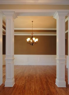 to cover that 2 x 4 maybe make a set done in shades of grey like they are stone and OLD Columns Inside, Basement Remodeling, Home Renovation, Foyer, Wanes Coating, Square Columns, Moldings, Crown Molding, Salon