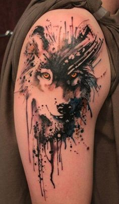 intriguing watercolor fox tattoo on upper sleeve. fascinating ...