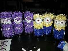 DIY minion center pieces. Purchased vases and filling paper at dollar store, printed out eyes and mouths. Total spent 10$ amazing!