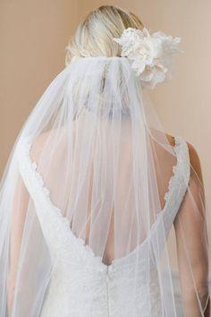 Velo del novia bajo el moño