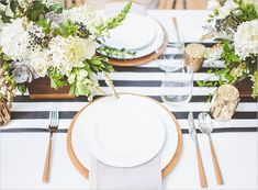 Table Decor for Our Wedding: Black & White Striped Runner, Gold Candles, Greenery, White Flowers & Gold Table Number Signs