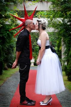 old school punk wedding - groom with a mohawk and cute and sexy bride