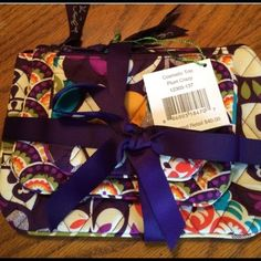 NWT Vera Bradley Cosmetic Trio in Plum Crazy. New Vera Bradley Cosmetic trio in Plum Crazy. This cosmetic trio includes three cosmetic bags, all with zipper closures.  The large bag measures approximately 9'' x 6.5'', the medium measures approximately 7'' x 5'' and the small measures approximately 5'' x 4''. All bags are brand new, with tags attached and secured with a beautiful coordinating ribbon. This would make a great gift. Thanks Vera Bradley Bags Cosmetic Bags & Cases