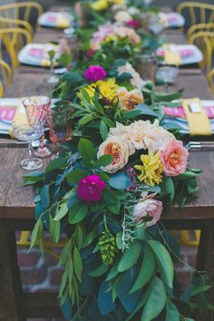 Long table runners with bright florals mixed in - lush floral runner we ❤ this! moncheribridals.com #weddingtablegarland #weddingtablescape #weddingcenterpiece