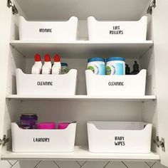 My laundry room organization! This is how I organize the storage in my laundry room -- with containers and labels! You can easily do this on a budget! #storage #organization #laundry | justanothermummyblog.com