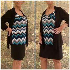 """SALEBlack open flyaway colorful design  1X Black open flyaway shock of colorful design  1X, turquoise, shades of blues, gray, white, black zigzag pattern with ruffled scoop neckline on front, solid black back and flyaway portion of front, 3/4 sleeves,  flyaway front longer than shell, collar 3"""" wide provides extra material for draping front, 46"""" bust, 18 """" sleeves, 29"""" length of shell, 32"""" length of front draping black flyaway,  never worn Tops Blouses"""