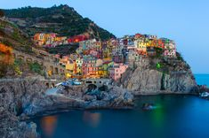 Manarola by Mike Walker  The setting sunlight draws out the color of the town of Manarola, Italy, part of the Cinque Terre National Park.
