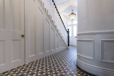 Full renovation on Trinity Road, London : Modern corridor, hallway & stairs by Grand Design London Ltd