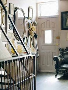 I adore this entry way. The mirrors and that fantastic chair really give this space some SERIOUS flare!