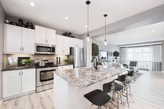 The Granite/Quartz on the Center Island is Unique and Very Beautiful! And I Love this Layout! ~ I'd Love to See the Rest of this Home Living Room Kitchen, Granite, Kitchen Ideas, Living Spaces, Rest, Quartz, Layout, Island, Unique