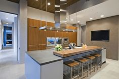 30 Comfortable Two-Tier Kitchen Islands Design Ideas - PinZones Tv In Kitchen, Modern Kitchen Island, Modern Kitchen Design, Kitchen Islands, Diy Kitchen, Kitchen Ideas, Küchen Design, Interior Design, Design Ideas