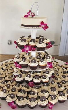 something like this minus the ridiculous look and cheesyness...but where the normal cupcakes are on the round table, on the stand would be gluten free cupcakes and on the top would be our cake!