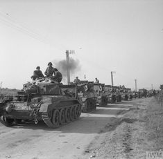A Crusader III AA Mk III tank, 'Skyraker' (aka 'The Princess') of Armoured Brigade, Armoured Division, leads a column of Stuart Mk V tanks moving off from Gold area, 7 June Crusader Tank, Normandy Ww2, D Day 1944, British Army, British Tanks, Man Of War, Military Armor, Armored Fighting Vehicle, Ww2 Tanks