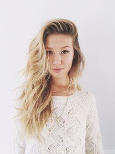 heavy side part with messy waves via the beauty department