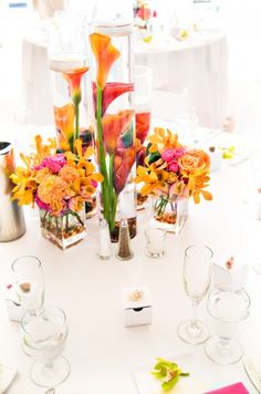 orange and pink tropical reception wedding flowers,  wedding decor, wedding flower centerpiece, wedding flower arrangement, add pic source on comment and we will update it. www.myfloweraffair.com can create this beautiful wedding flower look.