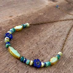 Perfect for layering! This listing is for a handmade, glass bead, boho necklace with blue, mint green, and teal Czech glass beads. These are all premium quality glass beads. The new flower shaped beads are so fun to mix and match in various designs that I ended up making several