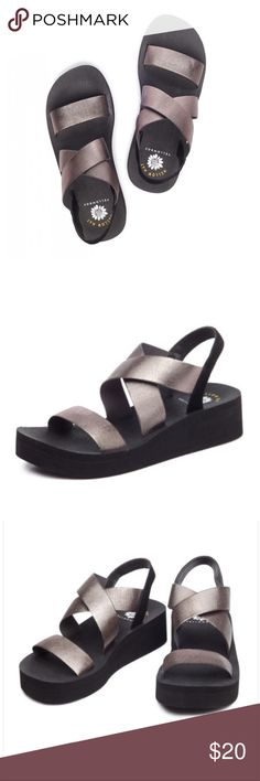 NEW! Yellow Box 'Bunkie' Sandal in Hematite New without Box. Light shelf wear. By Mellow Mat. Black sole, Hematite straps. Size: 5.5 Comfortable; Casual and classy, the Bunkie's  elastic cross-over strap is great for flexibility and comfort, while the dual density Mellow Mat EVA foam footbed gives all day comfort. Details * 1-inch Platform height // 1.75-inch Heel height * Rubber Outsole * MSRP*$55.00 Yellow Box Shoes Wedges