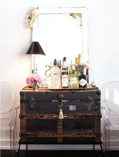 vintage trunk vanity // trunk dresser, large mirror, lucite chairs, ghost chairs, bar cart, liquor, old trunk, repurposed