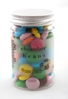 Fuschia Candy jar with coloured chocolate beans.  Great for table favours, kids party bags and token gifts for prizes.  £2.99 each from the Fuschia Boutique at www.fuschiadesigns.co.uk.