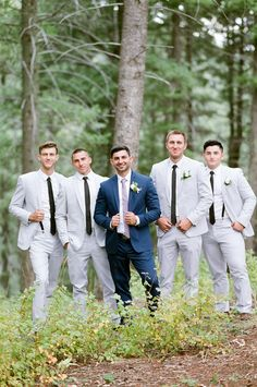 Groom in Navy Blue with Light Gray Suits for the Groomsmen