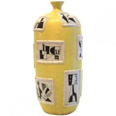 This yellow ceramic vase was designed in 1950 by Guido Gambone. Marked: Gambone.