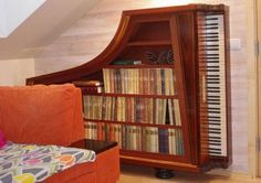 This classy bookcase fits neatly into the corner, don't you think? Entero, a custom furniture company in Estonia, made it from a ruined antique piano.