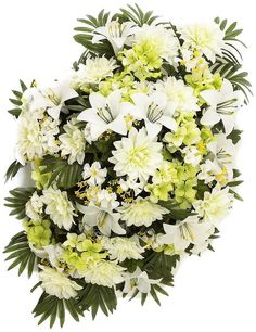 * Large headstone spray featuring a bountiful mound of artificial white and light green Dahlias. * Accented with fern leaves, small flowers, and other greenery to make a very full arrangement. * Displ