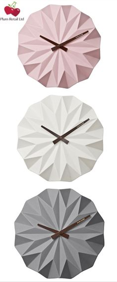 Karlsson Origami 3D Ceramic Wall Clock - £44.95 available in pink, white and grey with steel hands. For more stunning Karlsson Clocks, from £22.00, and many other home accessories including top brands such as Acctim, Frith and Stoneglow go to www.plumretail.com or follow us on Pinterest @plumretail
