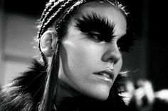 Oversized black feather eyebrows at Alexander McQueen AW14 PFW. More images here: http://www.dazeddigital.com/fashion/article/19141/1/top-ten-aw14-details
