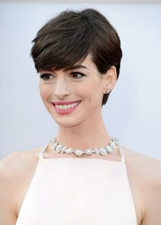 Short Hairstyles for 2014: Cute Layered Pixie Cut with Bangs for Thick Hair