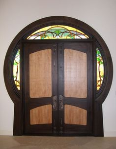 Beautifully made custom made door with ginkgo leaf latches and stained glass side and top panels in art nouveau style