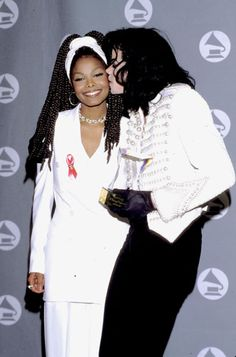 Michael and Janet Jackson shared a sweet family moment (in matching black and white looks) in the Grammys press room in 1993.