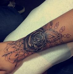 Wanting something like this, with a few roses in the middle to cover up my original tattoo, and delicate line work around it. But maybe not as much detail as this rose has, it's a bit too heavy