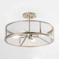"""Mesh, brushed metal and Edison bulbs are combined to create a timeless and sleek industrial semi-flush mount ceiling light.  Brushed Nickel finish. (11""""Hx19""""W).4x40 watts vintage Edison bulbs included! Canopy: 5.5"""" diameter"""
