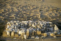 The city of Shibam, located in the central-western area of Hadhramaut Governorate, in the Ramlat al-Sab`atayn desert, is best known for its towering mudbrick skyscrapers. This small town of 7000 is packed with around 500 mud houses standing between 5 and 1