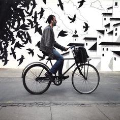 Cool black and white street art in Copenhagen (graffiti, urban art, public art, wall art, mural, Vesterbro, birds, houses, city bike, bicycle, biking, Copenhagen bicycle culture, sustainable green transportation)