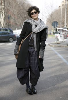 Coat:  Black Coat over Grey Cardigan  Pants;  Plaid COMME DES GARCONS Baggy Trousers  Shoes:  Black CHURCH'S Shoes  Bag:  Beige MIU MIU Bag  Gloves:  Grey Knit MARTIN MARGIELA Gloves  Scarf:  Long Grey Scarf