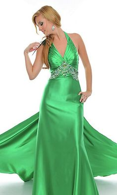 This emerald green dress would be great for a spring skin tone. Spring tones have light skin, auburn/strawberry hair, freckles, light eyes, and look best in greens and aquas and pale, light, or soft colors. This is emerald green so it contrasts with the auburn hair and complements the light skin.