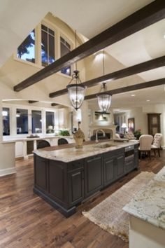 Open kitchen, love the high ceilings with lower beams, windows...