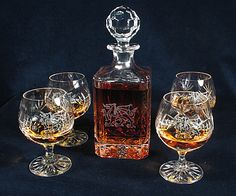 Engraved crystal goblets and decanter with the Welsh dragon