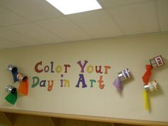 color your day in art - i used paint cans with colored tissue pouring from the cans
