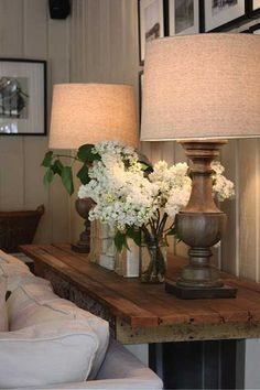 Adding Texture to Your Home {8 Easy Ways}  Love the look of the matching lamps at each end of sofa table and the gorgeous flower arrangement in the middle.