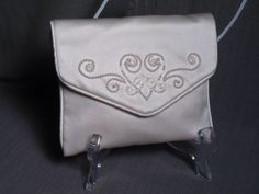 Silk purse- hand beaded clutch with 2 mm pearls from Japan & Swarovski crystals. For purchase and more designs available check out: https:// www.alterationsavenue.com