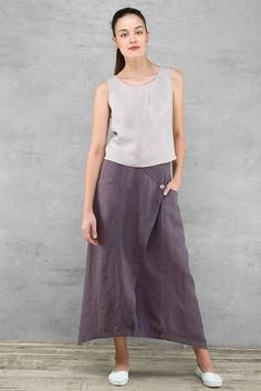 Long linen skirt, made of high quality purple blue pure linen (melange). Long, with two pockets. Elasticated waist. Its perfect for summer, also fashionable, modern, stylish. High quality sewing. Composition: 100 % linen. Pre washed. Measurements: detail measurements are in last photo. Perfect for high aprox. 168 cm Sizes: EU 36-44 EU 36- US 4- UK8 EU 38- US 6- UK10 EU 40- US 8- UK12 EU 42- US 10- UK14 EU 44- US 12- UK16 Easy care: hand wash/ machine wash (40).