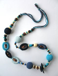 Nothing says summer like white mixed with bright colors. This Summer Fiesta necklace is bursts of brown, beige, blue and more colors. I used an