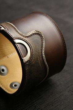 Leather cuff with guitar design.