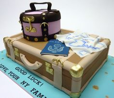 Vintage Luggage - A friend of mine is moving to London and this was the cake I made for her Bon-Voyage party. The  pink carry-all and the  tan suitcase are cakes. All luggage accents are fondant brushed with edible gold. Passport and Map are Gumpaste with hand-painted details.  Thanks for looking!