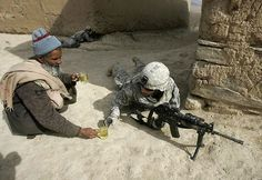 An Afghan man offers tea to an American soldier. - Imgur